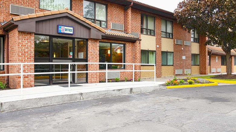 "Motel 6 Syracuse Exterior. Images powered by <a href=""http://web.iceportal.com""  target=""_blank"">Ice Portal</a>."