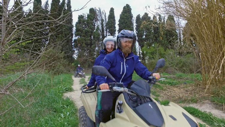 Health and wellness guru Mike Bledsoe rides an ATV through the French countryside with his wife.