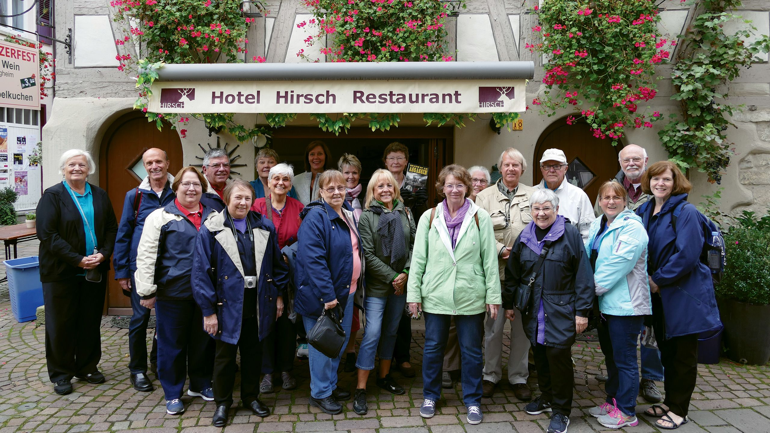 Kathy Wurth of Family Tree Tours, center in light green, leading a heritage travel group in Germany last year. Wurth was inspired to launch Family Tree Tours after going on a heritage tour with her mother in the 1970s.