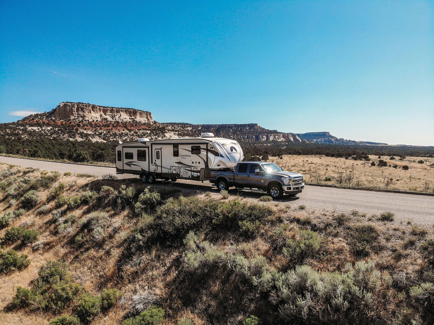 An RVshare travel trailer being towed on the open road. RVshare says bookings on its peer-to-peer rental marketplace have surged 650% since early April. (Courtesy of RVshare)