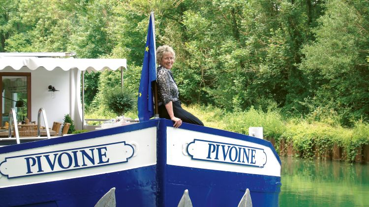 Jill Jergel on the bow of the Pivoine, Belmond's new eight-passenger barge, on an agent cruise in June in Champagne, France. Barge cruising in France makes up between 50% and 70% of Jergel's business at Frontiers International Travel in Gibsonia, Pa.