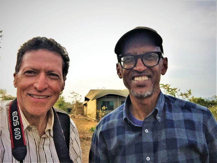 Travel Weekly editor in chief Arnie Weissmann, left, and Rwandan president Paul Kagame in Akagera National Park.