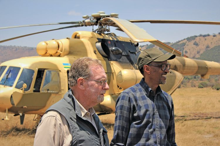 CBS News travel editor Peter Greenberg and Rwandan president Paul Kagame arrive by helicopter at Akagera National Park.