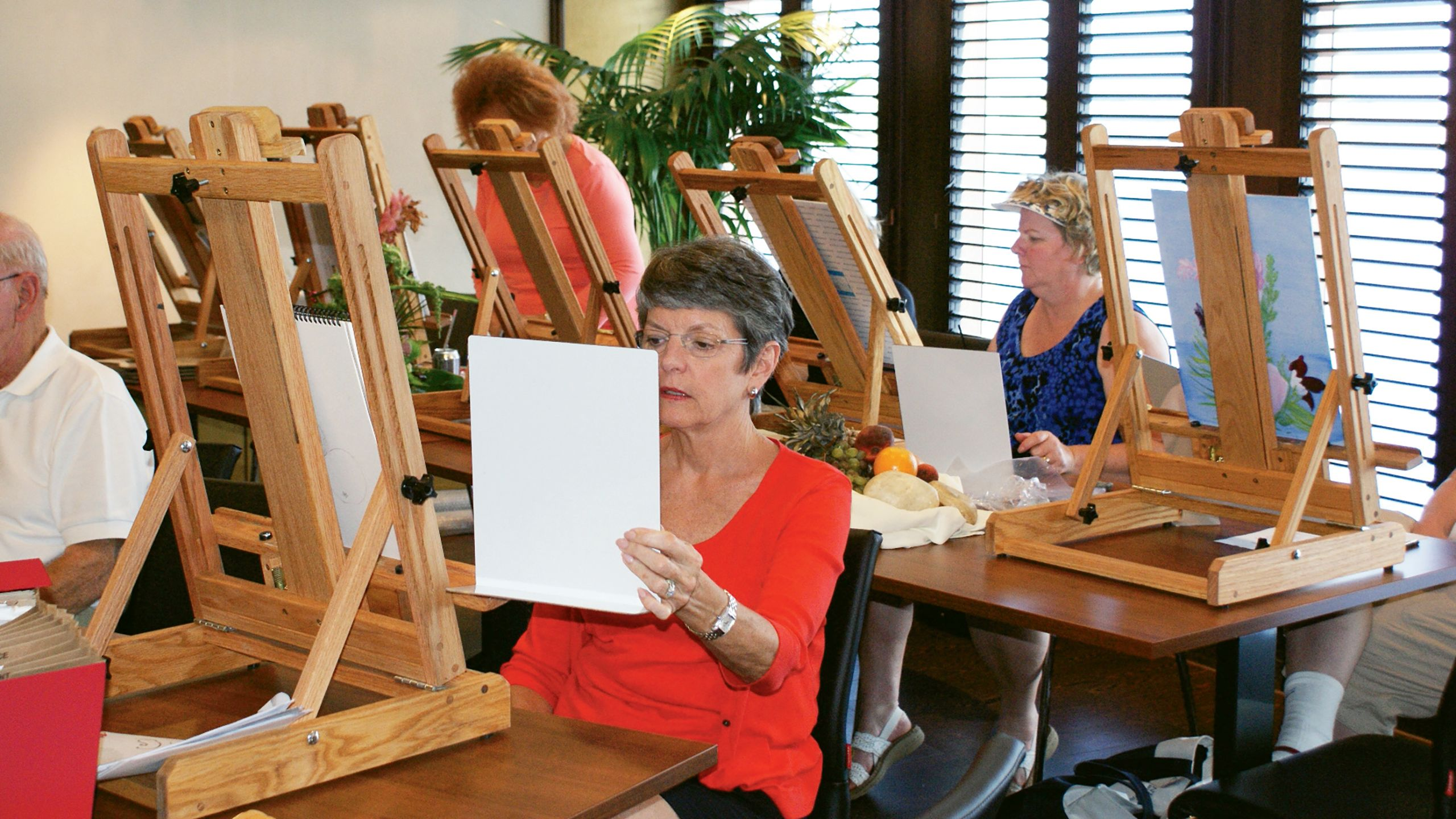 The Artist Lofts on  Oceania Cruises provide a workshop for passengers and instruction from an artist-in-residence.