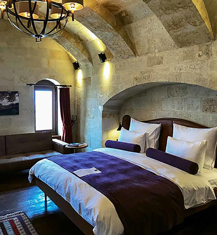 A suite at the Ariana Sustainable Luxury Lodge, which has 11 suites developed around an ancient cave home in Cappadocia.