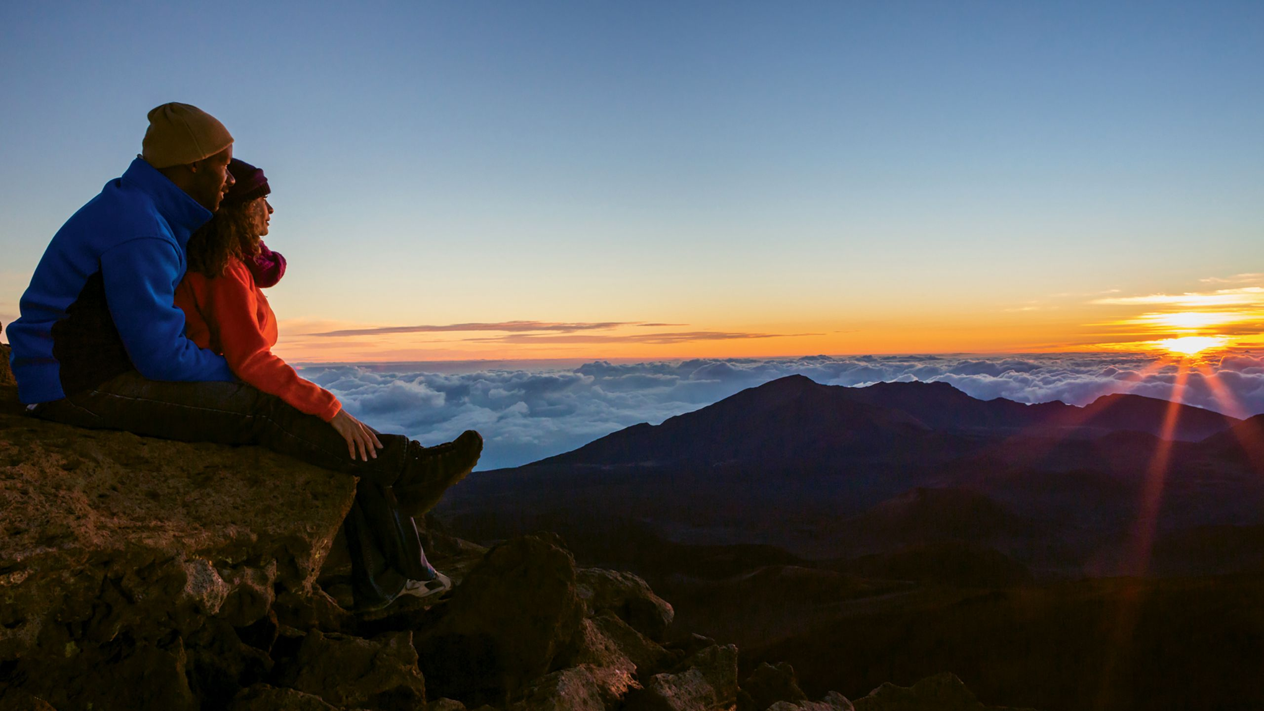 In 2017 a reservation system was instituted to control sunrise viewing crowds at Haleakala National Park on Maui. Photo by Tor Johnson/HTA