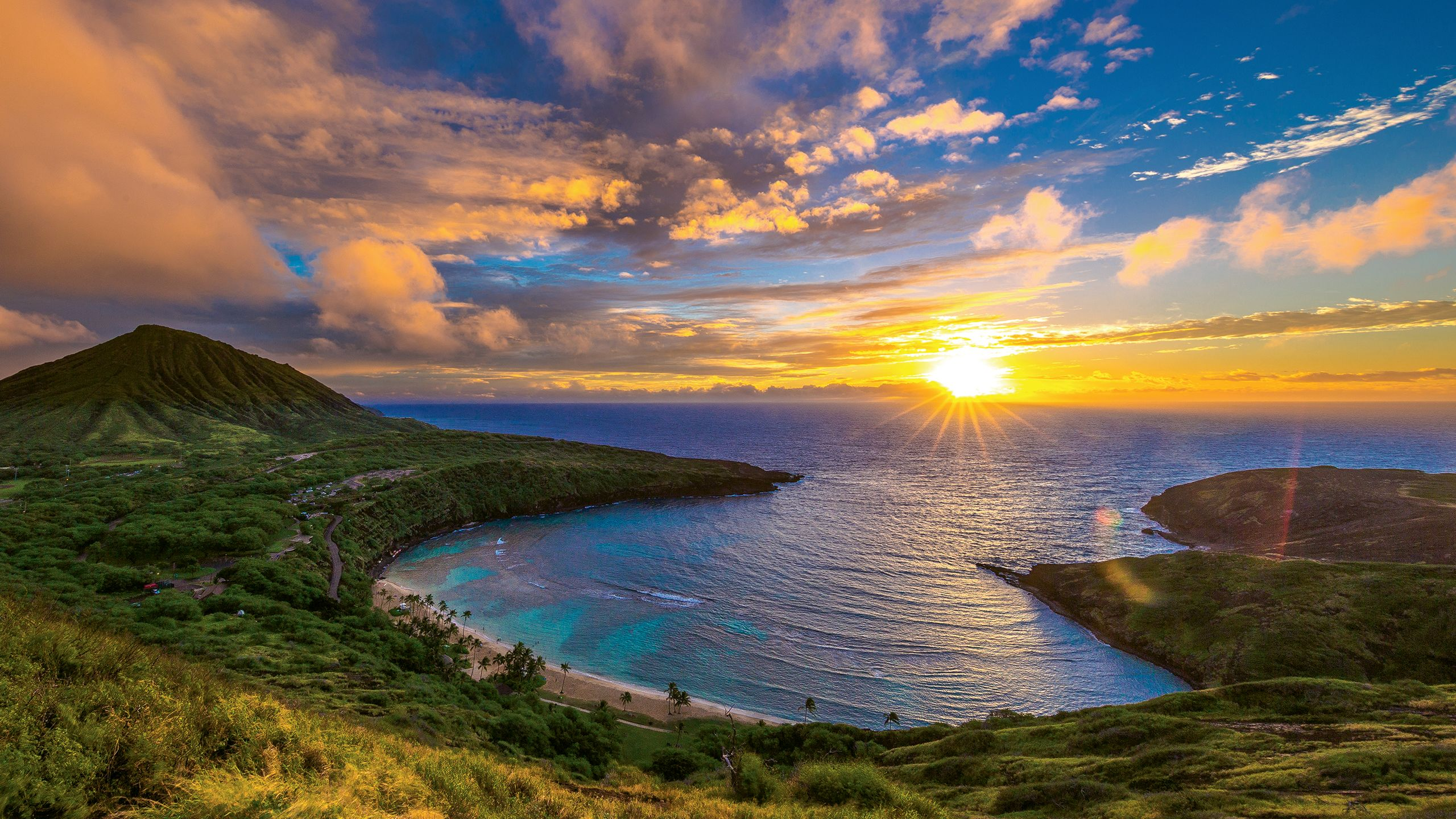 Sunrise from Hanauma Bay Nature Preserve on Oahu. The park is closed one day a week, and first-time visitors must watch a video on safety and conservation. Photo by Shane Myers Photography/Shutterstock.com
