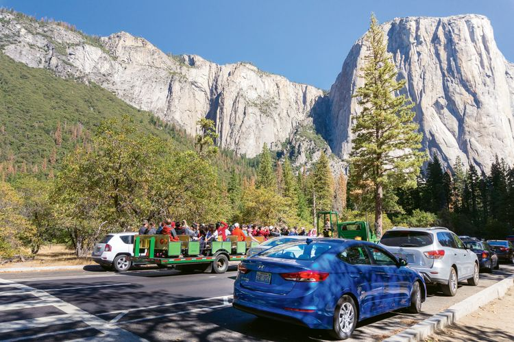 Tourists' vehicles lined up to enter Yosemite National Park. Tech improvements, such as web fee payment, might ease congestion at park entrances. (Photo by Ayrat A/Shutterstock)