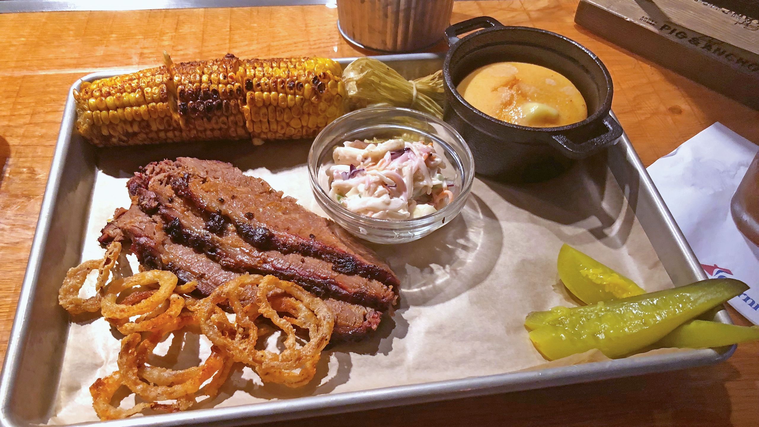 Brisket and sides at the Pig & Anchor on the Carnival Horizon. Photo by Tom Stieghorst