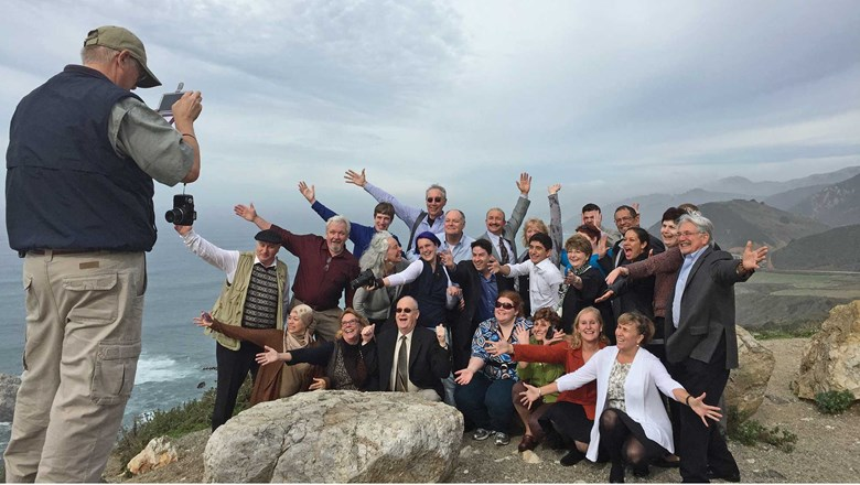 Students of the International Tour Management Institute take a group photo on Highway 1.