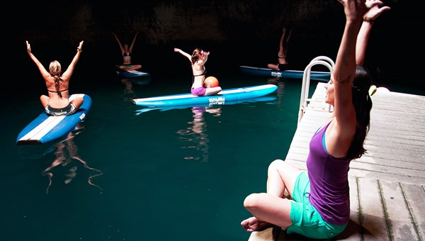 Park City Yoga Adventures offers a paddleboard yoga class in the natural hot springs at the 10,000-year-old Homestead Crater.