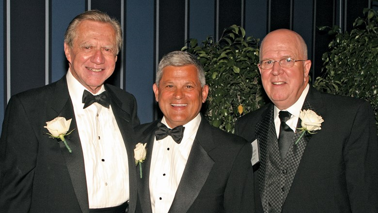 From left, Gilbert Haroche, Mayflower Tours founder John Stachnik and Bruce Beckham of Tourism Cares at a Tourism Cares event in 2005.