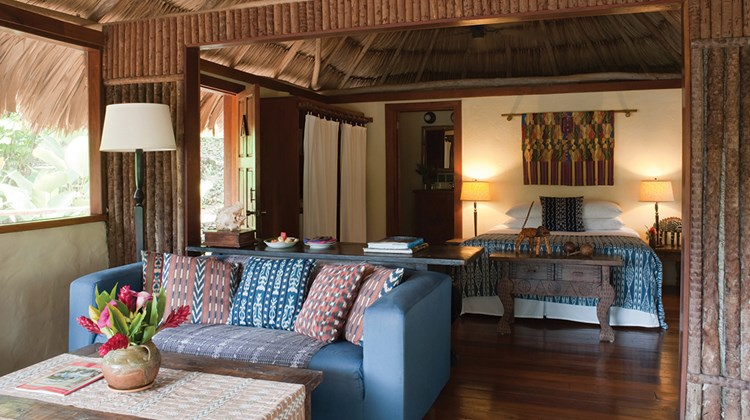 The lodge's thatched roofs help keep the rooms ventilated.