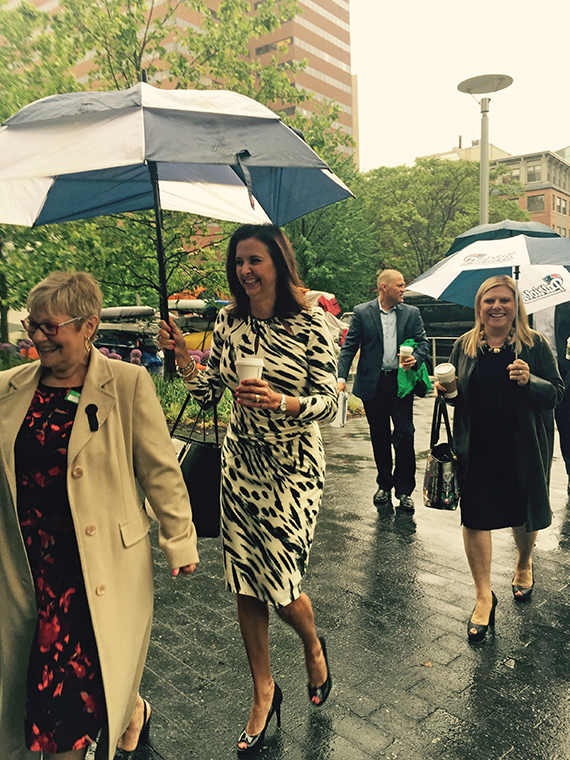 Celebrity Cruises Senior Vice President Dondra Ritzenthaler, in black-and-white dress, and Celebrity Cruises CEO Lisa Lutoff-Perlo, in black dress, arrive in rainy Boston to meet with representatives of World Travel Holdings.