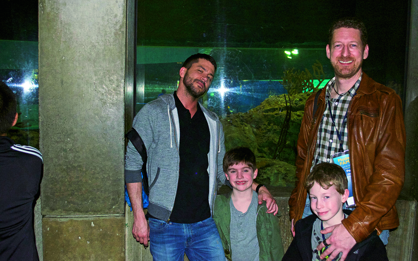 Blogger and journalist Frank Lowe with his son, Briggs, join the author and his son at the National Aquarium. Photo Credit: Courtesy of Paul J. Heney