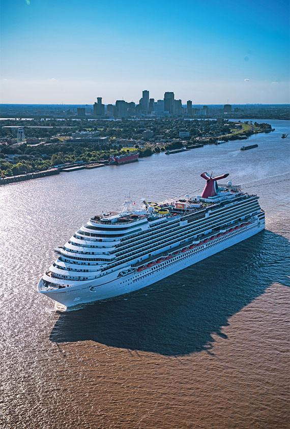The Carnival Dream sailing out of New Orleans, one of two Carnival Cruise Line vessels that homeport year-round in the city.