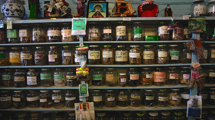 The shelves of a Botanica store in New Orleans, where Voodoo is still a thriving religion.
