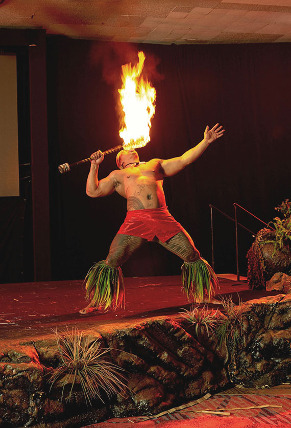 A Samoan fire knife dancer is part of the new dinner show at the Sheraton Princess Kaiulani.