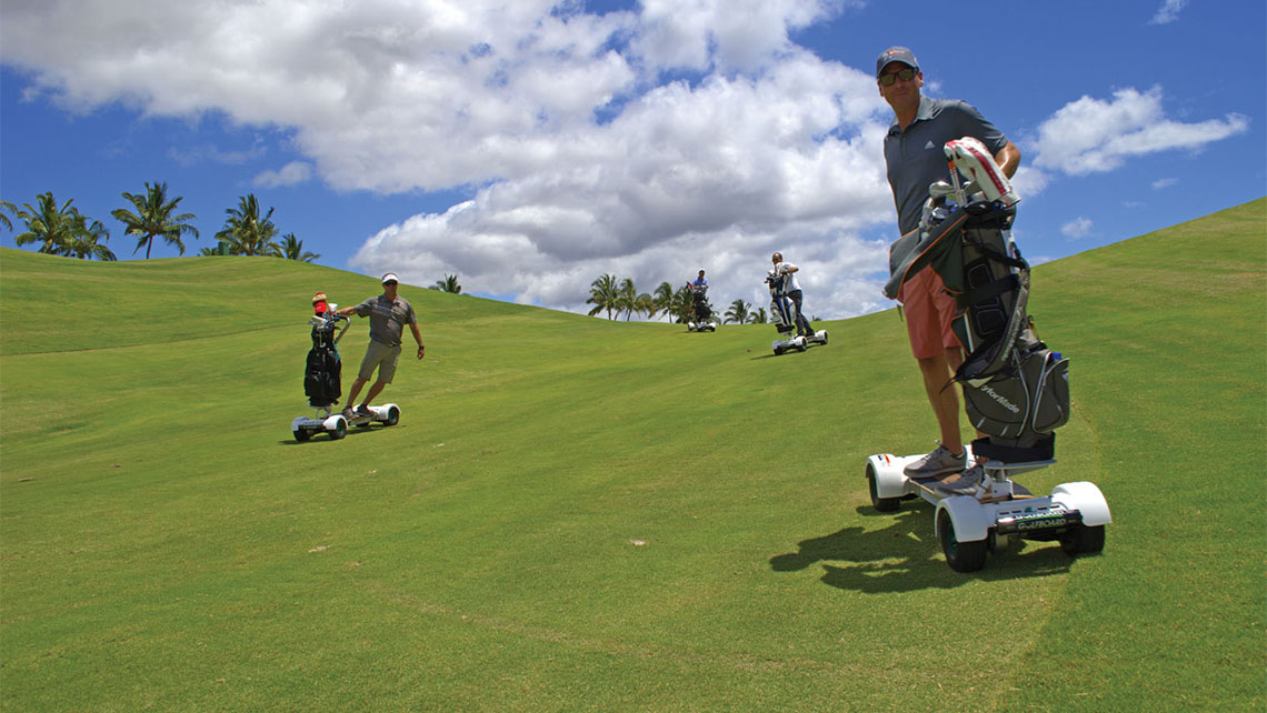 Four men try out GolfBoards at the Mauna Kea Resort on the Big Island. Photo Credit: Andrew Crawford