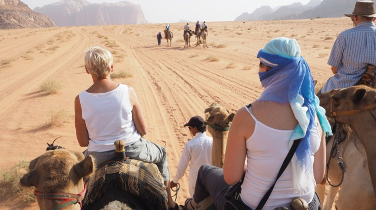 When travelers think of Jordan, they usually conjure up images of the ancient city of Petra. And Petra is, without a doubt, an awe-inspiring sight to behold. But Jordan is also so much more than Petra. Pictured here, an Intrepid Travel tour group rides camels into Jordan's Bedouin desert region, Wadi Rum.