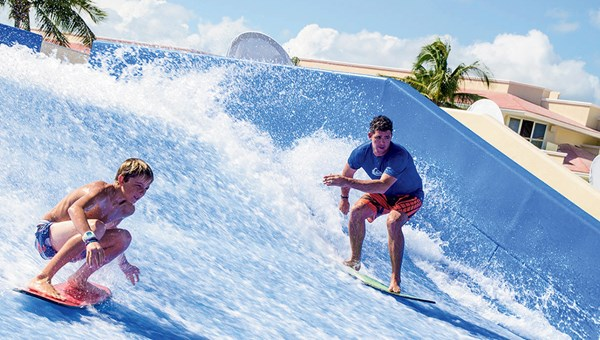 Kids enjoy the FlowRider at Moon Palace Golf & Spa Resort in Cancun.