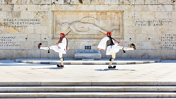 From Athens' ancient cultural icons to the cuisine of the Peloponnese peninsula and the serenity of the Aegean islands, Greece's tourism numbers are booming. Pictured here, the changing of the guard, as seen from the Hotel Grand Bretagne, which is centrally located on Syntagma (Constitution) Square.