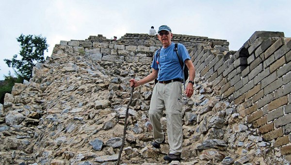 Clint Blandford on a hike of an unrestored section of the Great Wall. The retired teacher has been to 120 countries by the Century Club's count.