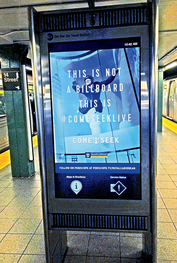 "Royal Caribbean's ""Come Seek Live"" display at the Union Square subway station in New York. It featured streaming Periscopes and video images from the campaign's TV ads. Photo Credit: Johanna Jainchill"