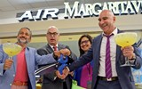 Javier Gavilian, left, formerly of IMC, an airport restaurant operator; Miami-Dade Aviation Director Emilio Gonzalez; Air Margaritaville's Paula Irizzary; and IMC CEO Jaime Szulc celebrate the opening of the Air Margaritaville restaurant at Miami Airport.