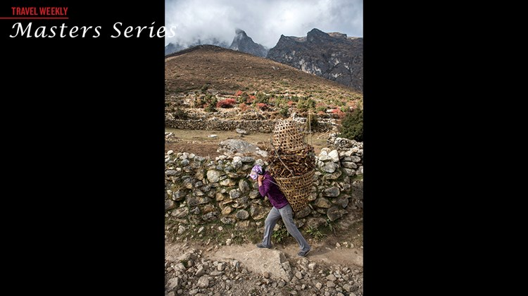 A woman carries a load of leaves in the Himalayan village of Pangboche. The Rebound Nepal program was designed to bring attention to Nepal to help rebuild its tourism industry after the devastating earthquake in April.