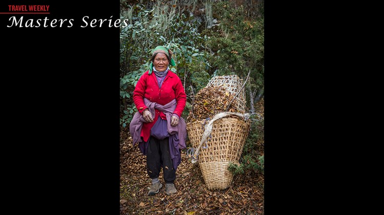 A woman and her basket of leaves near Khumjung in the Himalayas.