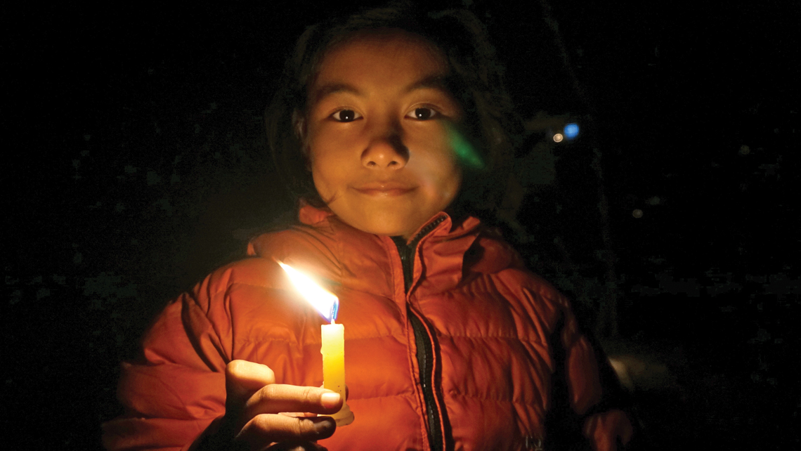 Laxmi, the author's 10-year-old guide around Camp Hope and through the rituals of Diwali. Photo Credit: Jeff Greenwald