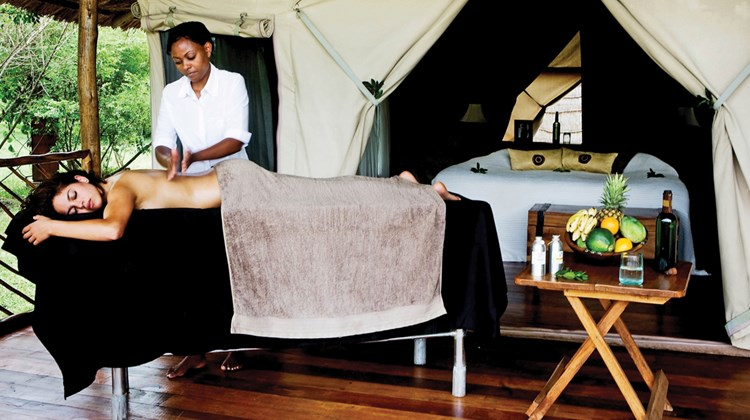 Wellness treatments at the spa at the Karen Blixen Camp in the Masai Mara are performed in private, outdoor verandas and focus on improved energy.<br /><br /><strong>Photo Credit: Abe Peck</strong>