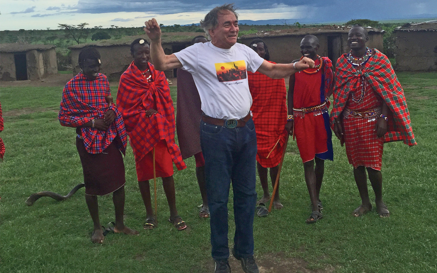 The author shows off his jumping ability to warriors in a Maasai village. Photo Credit: Courtesy of Abe Peck