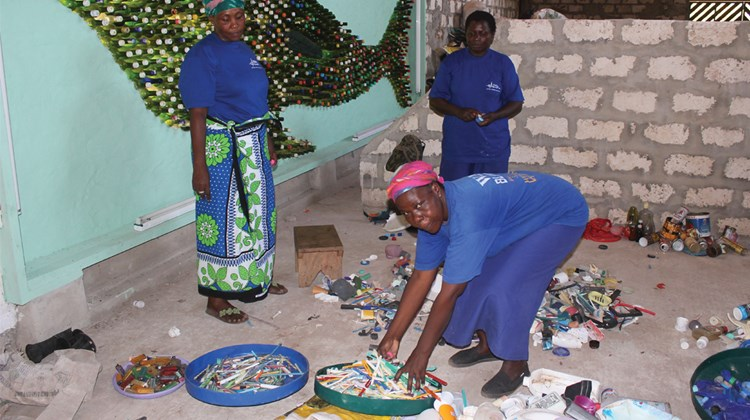 A 250-member team consisting of locals operate waste management and recycling equipment at a recycling center in Watamu.<br /><br /><strong>Photo Credit: Abe Peck</strong>