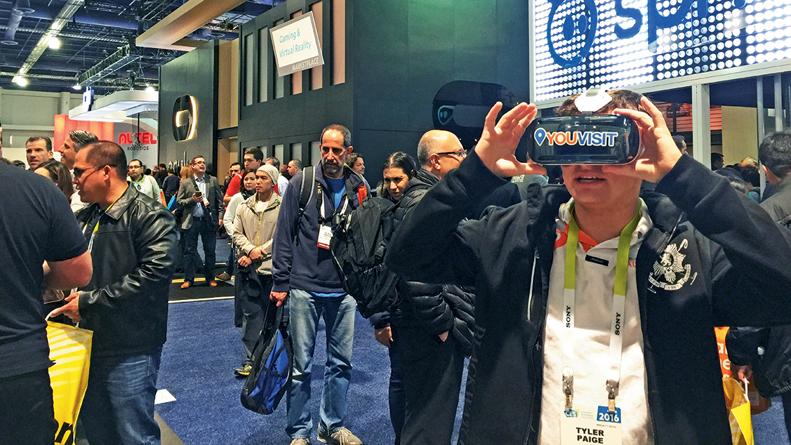 An attendee checks out the YouVisit VR experiences at the Consumer Electronics Show. Photo Credit: Michelle Baran