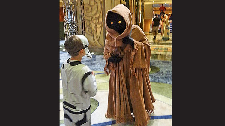 A young passenger dressed as a Stormtrooper approaches a Jawa at a Star Wars character meet-and-greet.<br /><br /><strong>Photo Credit: Johanna Jainchill</strong>