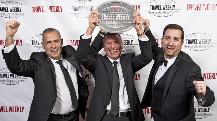 During a black-tie gala dinner and ceremony at the Conrad New York on Dec. 15, Travel Weekly honored the best of the best in airlines, car rentals, hospitality, rail tours, GDSs, agent education, tour operators, cruising, destinations and theme parks. Pictured here, Alex Pinelo, Andy Stuart and Nathan Hickman of Norwegian Cruise Line.