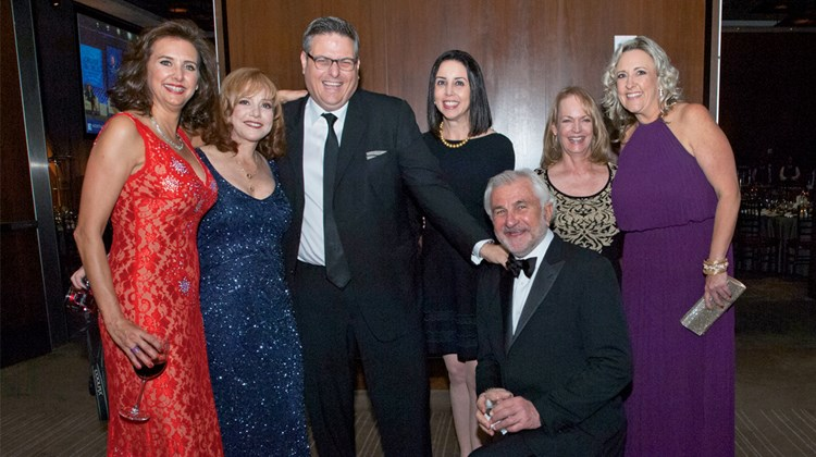 Bill Smith of Virtuoso, kneeling, with (from left) Dondra Ritzenthaler of Celebrity Cruises, Vicki Freed of Royal Caribbean International, Alex Sharpe of the Signature Travel Network, Lara Leibman of Frosch, Paula Hayes of Globus and Tracy Sedlak of Club Med.