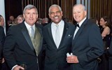 Arnold Donald of Carnival Corp., center, with Bob Sullivan, left, and Jay Nelson of Travel Weekly.