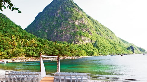 St. Lucia's Sugar Beach, a Viceroy Resort offers eight wedding venues. Pictured, a beach wedding setup at the property.