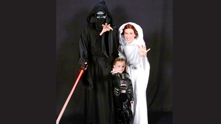 David Riggans as Kylo Ren, his wife, Lorelei Puebla as Princess Leia, and daughter, Elisa Riggans, as Darth Vader, doing a &#39;&#39;Force Push.&#39;&#39;<br /><br /><strong>Photo Credit: Johanna Jainchill</strong>