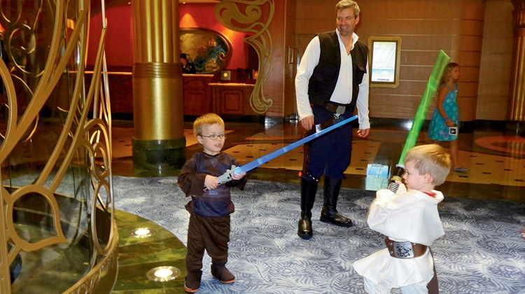 Rick Ronchetti, a passenger from North Caldwell, N.J., plays the role of Han Solo while his sons, Logan 4, as Luke, and Colin 7, as Anakin, battle with lightsabers.<br /><br /><strong>Photo Credit: Johanna Jainchill</strong>