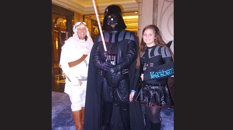 The Slater family, Kara, Matt and 10-year-old Kathan, of from Rainsville, Ala., dressed up as Rey, Darth Vader and Darth Vader.<br /><br /><strong>Photo Credit: Johanna Jainchill</strong>