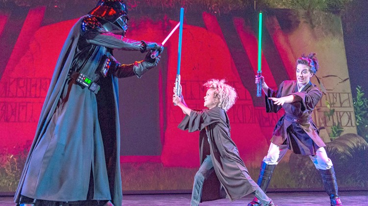 During Disney Cruise Line&#39;s first Star Wars Day at Sea aboard the Disney Fantasy, passengers -- many decked out in impressive and realistic Star Wars costumes -- took part in trivia challengers, deck parties, special menus and meet-and-greets, among other activities. Pictured here, is &#39;&#39;Jedi Training: Trials of The Temple,&#39;&#39; where kids learn the ways of the Jedi and put their skills to the test in a final battle with the Sith Lord, Darth Vader.<br /><br /><strong>Photo Credit: Johanna Jainchill</strong>