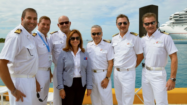 Carnival President Christine Duffy in Cozumel with bridge officers from several ships.