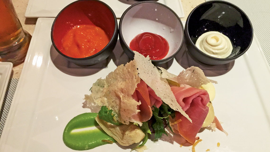 The appetizers at the Salty Dog gastropub on Princess Cruises include Parma ham and three sauces: BBQ, garlic mayo and piquillo.