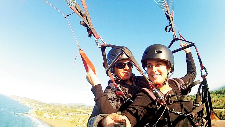 Student travelers go skydiving in Spain, an up-and-coming spring break destination according to StudentUniverse.
