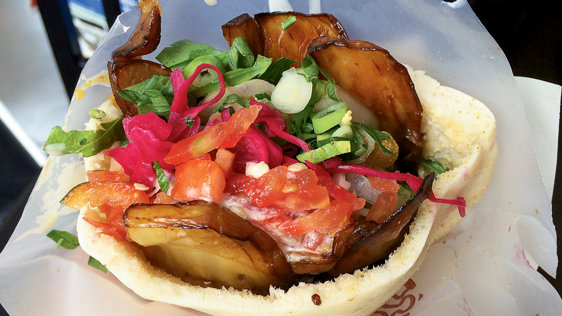 The Sabich sandwich shop near the Carmel Market featured a traditional pita sandwich of fried eggplant and toppings. Photo Credit: Matthew Wexler
