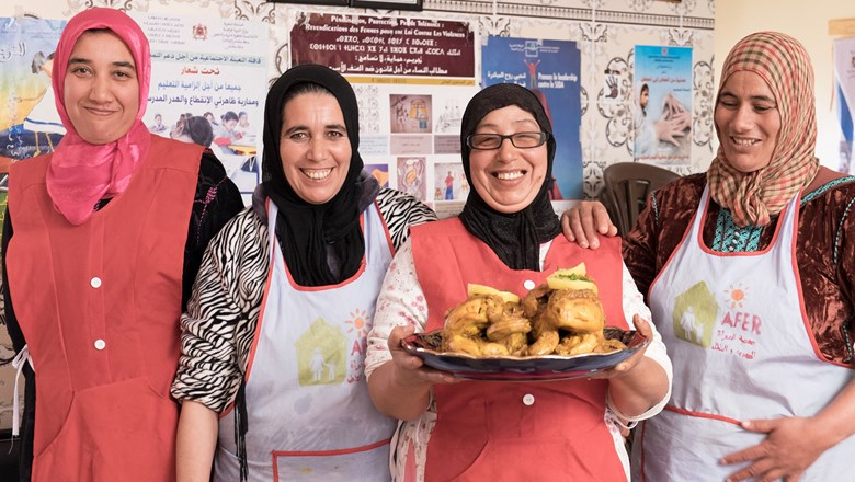 Moroccan women in rural Meknes with traditional dishes prepared for guests.